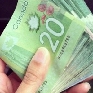 17023689_web1_190527-NBU-Canadian-cash-web